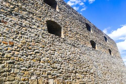 The old stone castle defensive wall. Historical site.