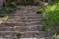 The old stone steps on a hill rising on either side grass.