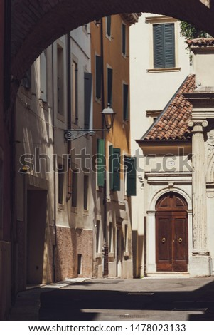 The old street of Verona, with a facade and a door. Lane in Verona