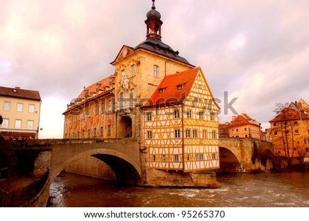 The Old Town Hall (1386) of Bamberg(Germany) was built in the middle of the Regnitz river, accessible by two bridges . The Old Town of Bamberg is listed as a UNESCO World Heritage.