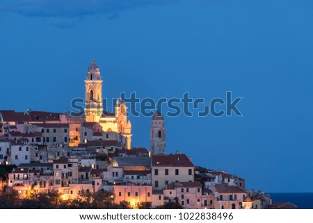 The old town of Cervo, Liguria, Italy, with the beautiful baroque church arising from the houses. Clear blue sky. #1022838496
