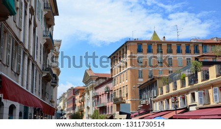 The old town of the city of Nice at Cote d Azur in South France, colorful historical houses from the period of belle epoque architecture, blue sky, sunny