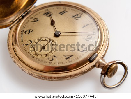 The old watch with marks of use isolated