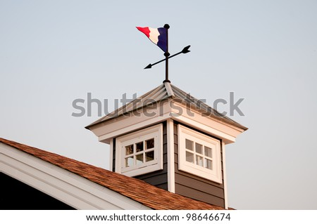 The Old weather vane on roof top - stock photo