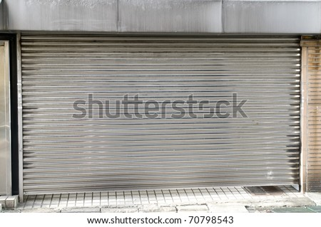 The old white steel coiling door