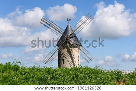 The old windmill of Largny-sur-Automne aka 'Moulin de Wallu' (in french) on a sunny day, located in Aisne department, France. Formerly used to grind cereal grain into flour, mainly wheat. Photo stock ©
