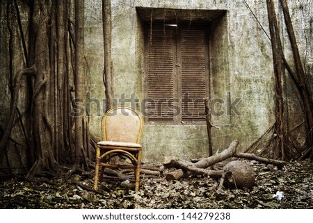 the old windows, the root and the old chair with the old wall on background - grunge and textured