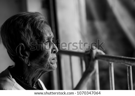 The old woman's felling lonely. ,she's senior woman in family and the elderly. Stock photo ©