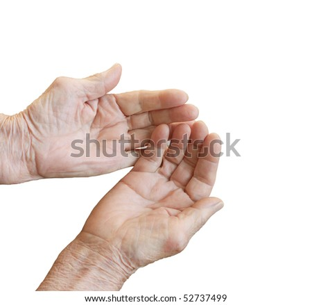 The old woman's hands folded in a handful of white background