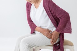 The old woman who has a pain in a hip joint