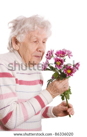 The old woman with bunch of flowers