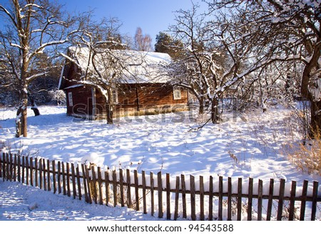 The old wooden house in a winter season