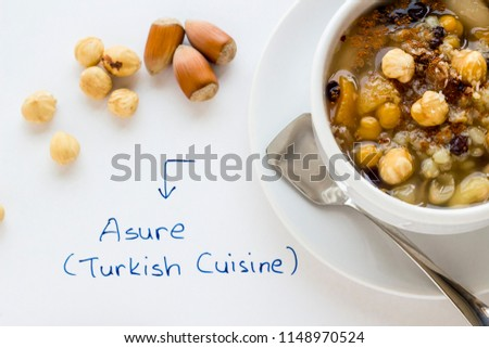 The Oldest Dessert Ashura or Asure in the world.Traditional dessert to serve on the 10th day of the Muslim month Muharrem, the first month of the Islamic calendar.Handwriting Asure on white ground.