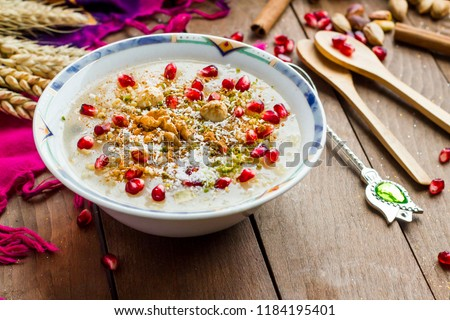 The Oldest Dessert In The World,Asure or Ashura(Noah Pudding)traditional dessert to serve on the 10th day of the Muslim month Muharrem, the first month of the Islamic calendar.Wooden table.