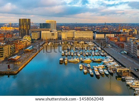 The oldest harbor district of Antwerp city called Eilandje at sunset in use as a yacht marina with waterfront promenade, Antwerp Province, Belgium. #1458062048