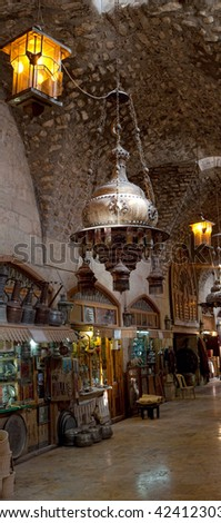 The oldest part of the souk in Aleppo, Syria. Detail with lamps.