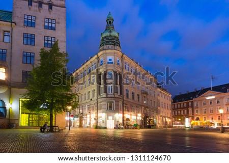 The oldest square Gammeltorv or Old Market in Old town during morning blue hour, Copenhagen, capital of Denmark #1311124670