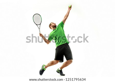 The one caucasian man playing tennis isolated on white background. Studio shot of fit young player at studio in motion or movement during sport game.. #1251795634