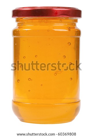 The only closed glass jar with honey. Isolated on white background. Studio photography.