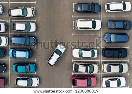 The only vacant parking space in parking lot. Navigation in the car park. Searching for vacant space for parking. The parking is jammed with cars. problem. Finding a vacant place.