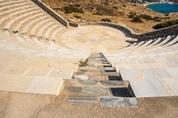 The open-air theatre Odysseas Elytis made of stone and marble in the ancient Greek style on Ios Island. Cyclades Islands, Greece