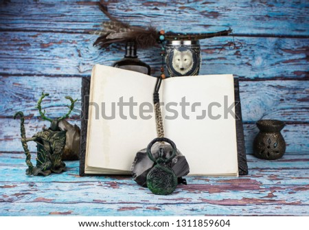 Feather and old open book Images and Stock Photos - Page: 4