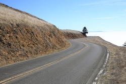 The Open, Curvy Road, Marin County, San Francisco Bay Area, Northern California. Mount Tamalpais is known for its numerous hiking trails, biking trails and sweeping views of the San Francisco Bay.
