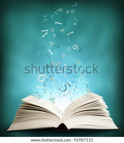 The  open Magic Book and the letters on a dark background
