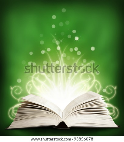 The  open Magic Book with sparklings on an green background