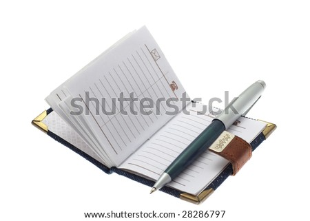 The opened notebook and ball pen on a white background
