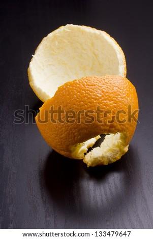 The orange peel on the black top.