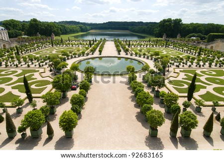 The Orangerie garden of Versailles Palace, Paris, France. And in the far distance have a lake that is the Pond of the Swiss.