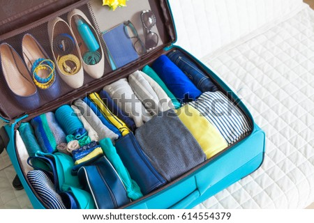 The order in the suitcase. Collect clothes on the trip.