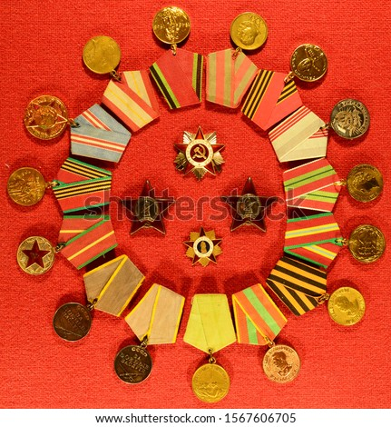 """The order of the """"Patriotic war"""", two orders of the """"red Star"""" with the words """" USSR """"and"""" Proletarians of all countries unite"""", the sign """"front-line soldier"""" and a group of medals of the USSR."""