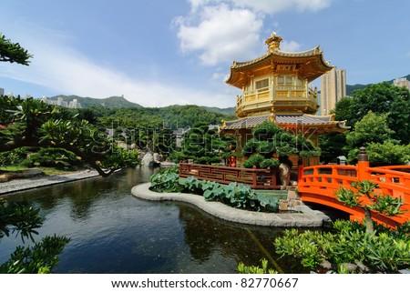 The oriental gold pavilion of absolute perfection in Nan Lian Garden, Chi Lin Nunnery, Hong Kong - stock photo