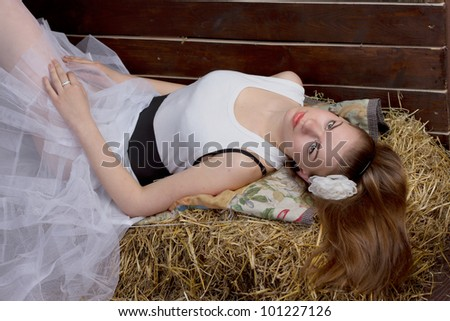 The original wedding - the bride is wearing rubber boots in the hay - stock photo