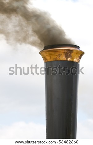 The ornamented smoke stack of a steam traction engine