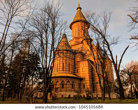 The Orthodox Metropolitan Cathedral from the nearby park in Timisoara, Timis County, Romania. Lighted Orthodox Metropolitan Cathedral at dusk, Timisoara, Romania #1045105684