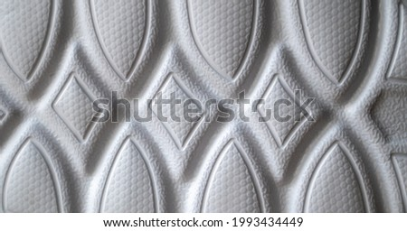 The outsole of new white sneakers. Rubber sole for men's shoes. Sole for sports and walking shoes. The texture of the material of sports shoes. Foto d'archivio ©