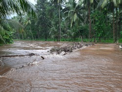 The overflow of water over the bridge due to flash flood by the rain in Kerala
