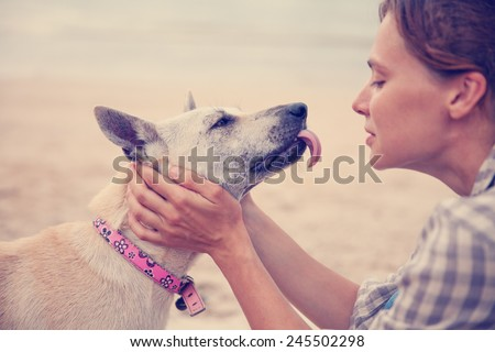 The owner with her dog on the beach. Best friends,