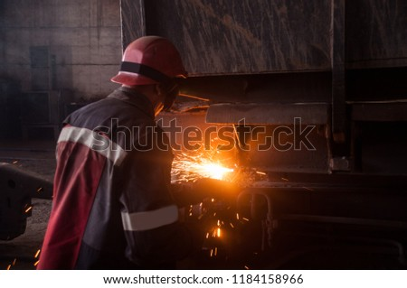 the oxygen cutting operator cuts the worn out part from the railroad freight car. ストックフォト ©