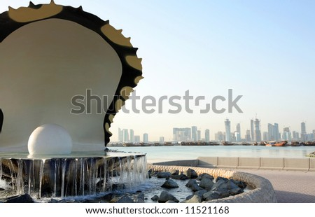 The oyster and pearl fountain in Doha, Qatar, with the skyline of the new high-rise district seen  in the background. April 2008