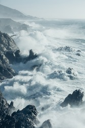 The Pacific Ocean coastline, with waves crashing against the shore