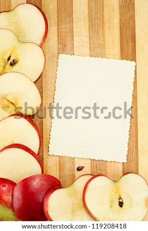 The page of the culinary book decorated with apples with a place of a copy for your record or page of a photograph album