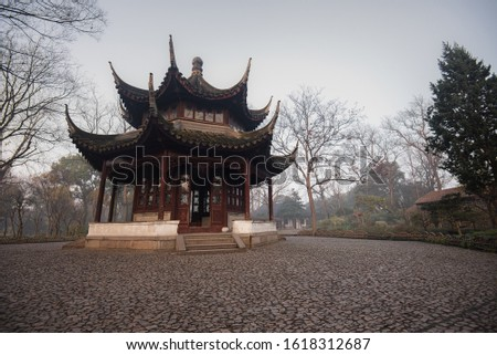 The Pagoda at Humble Administrator Garden(Zhuozheng Garden) in a mist early morning.Zhuozheng Garden a classical garden,a UNESCO World Heritage Site and is the most famous of the gardens of Suzhou.