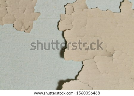 The paint is peeling, the wall as a background, the old coating, expressive cracks in the paint. Stock photo ©