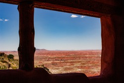 the painted desert through a opening on the patio of the painted desert inn