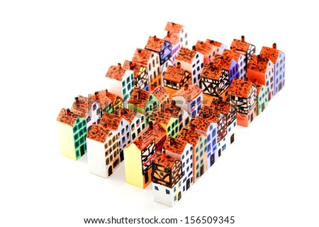 The painted wooden models of typical  buildings of European cities on a small scale on a white background