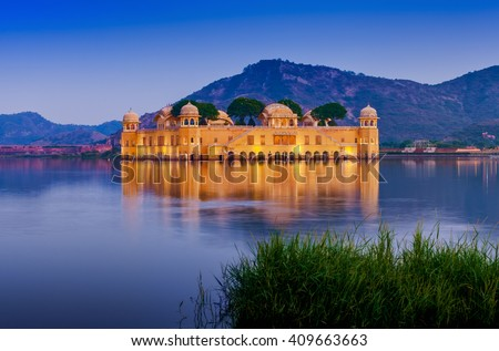 The palace Jal Mahal at night. Jal Mahal (Water Palace) was built during the 18th century in the middle of Man Sager Lake. Jaipur, Rajasthan, India, Asia #409663663
